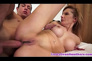 Lusty granny with faketits acquires anal creampie