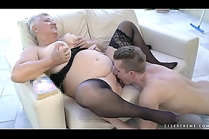Broad in the beam grandma'_s breast covered with jizz