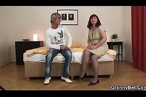 Old granny in stockings rides stranger'_s cock