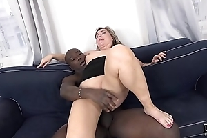 Chubby Mom Chubby Irritant Copulates Enduring In Interracial Porn Pic takes mouthful of cum