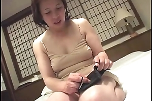 Asian granny inserts a vibrator approximately will not hear of indecorous cleft