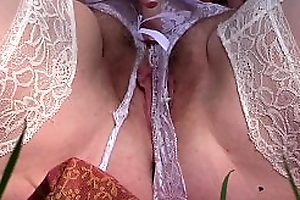 Mature hairy pussy closeup outdoors. Milf in white stockings masturbates in eradicate affect heed to to orgasm.