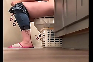 Mature milf caught in bathroom voyeur