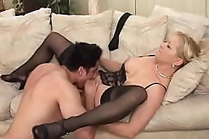 Mature blonde Ami Charms in stockings gets will not hear of pussy boned by a younger man